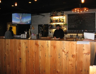 Wainscot wall paneling separates the bar from the restaurant.